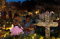 November 2, 2018 - Kolkata, India - A lady and her daughter lighting candle on the grave of her grandmother on the occasion of All Souls Day at a cemetery in Kolkata. (Credit Image: © Debarchan Chatterjee via ZUMA Wire)