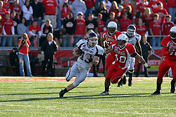 18 October 2008: Cody Kirby keeps the ball and runs right with Doni Phelps and Pat Cucci closing in during a game which the Missouri State Bears came from behind to beat the Illinois State Redbirds 34-28 in front of 13,292 fans at Hancock Stadium on Illinois State Universities campus in Normal Illinois