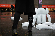 Extinction Rebellion activists having left sculptures by the artist Gray made out of ice outside the art gallery Tate Modern, February 4th 2019, Central London, United Kingdom. The pieces look like life jackets and are meant to represent both the climate and refugee crisis.