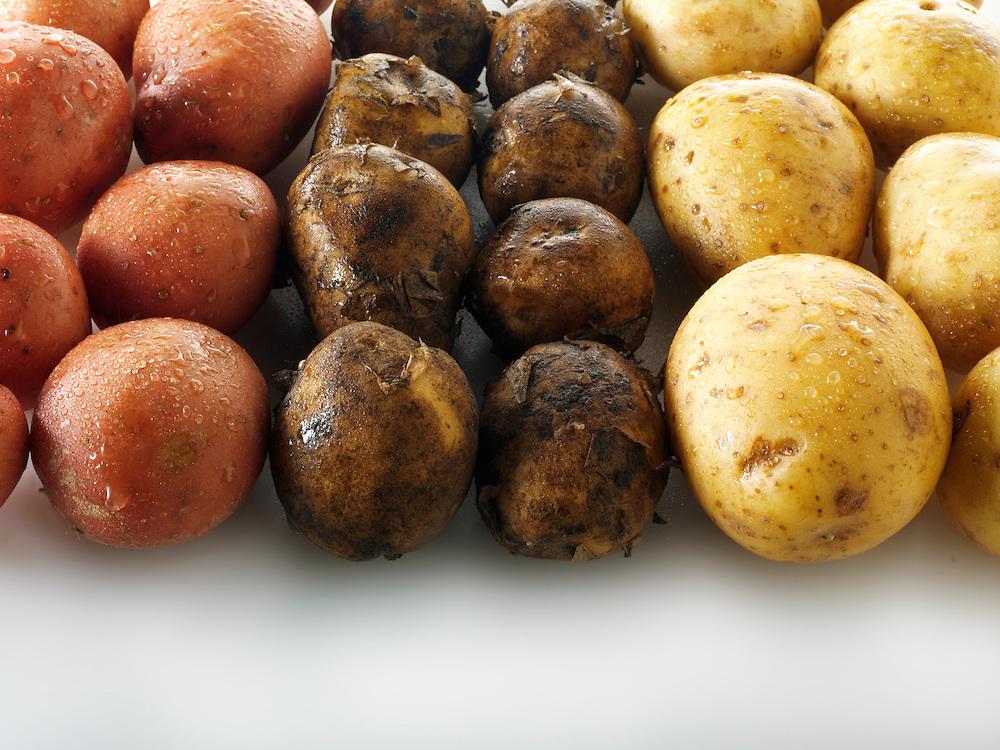 Mixed fresh un-cooked potatoes
