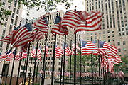 rows of American flags at the Rockefeller center in New York City