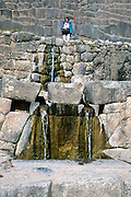 """Around 1450 AD, the Incas diverted a spring through impressive stone work and waterfalls at the archaeological site of Tambomachay (El Baño del Inca), 8 km north of Cuzco, in Peru, South America. Tampumachay means """"collective housing resting place"""" in Quechua language. The Incas perfected stonecraft to an amazing degree."""
