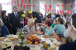The Duchess of Cornwall meets residents from Tregunnel Hill, Cornwall, a mixed-use neighbourhood built on Duchy of Cornwall land in Newquay comprising open-market and affordable homes, as they have a picnic lunch inside Newquay Fire Station.