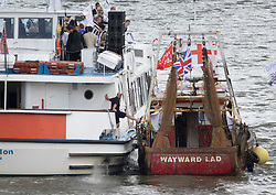 © Licensed to London News Pictures. 15/06/2016. London, UK.  member of the crew on an 'In' boat pushes away a Vote Leave boat as it gets too close as campaigners converge on the Thames near Parliament. Photo credit: Peter Macdiarmid/LNP