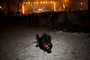 New Year's Eve (December 31) in Belgrade, Serbia. Parliament square and Pionirski Park. A couple enjoying a private moment during the festivities.