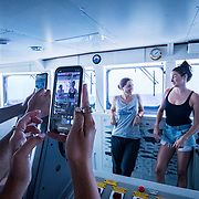 Shailene Woodley and scientist Celia Ojeda Martinez give a live webcast about ocean plastics in the ships bridge. The Greenpeace ship Esperanza during its expedition to the Sargasso Sea, a unique region in the North Atlantic Ocean that is home to a diverse array of marine life, including loggerhead and green sea turtles.  The journey will see Greenpeace and University of Florida researchers team up to study the impact of plastics and microplastics on marine life and the importance that the Sargasso's drifting Sargassum seaweed habitat has for the development of juvenile sea turtles.