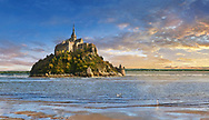 """Scenic sunset view of the tidal island  of Mont Saint Michel at high tide surrounded and its medieval abbey of Saint Michel. Normandy France.<br /> <br /> The tides vary greatly, at roughly 14 metres (46 ft) between highest and lowest water marks. Popularly nicknamed """"St. Michael in peril of the sea"""" by medieval pilgrims making their way across the flats, the mount can still pose dangers for visitors who avoid the causeway and attempt the hazardous walk across the sands from the neighbouring coast. .<br /> <br /> Visit our MEDIEVAL PHOTO COLLECTIONS for more   photos  to download or buy as prints https://funkystock.photoshelter.com/gallery-collection/Medieval-Middle-Ages-Historic-Places-Arcaeological-Sites-Pictures-Images-of/C0000B5ZA54_WD0s"""