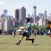 Players in action during the 7th Annual AIG NYC Rugby Cup at Randall's Island, Manhattan, with the Manhattan skyline providing the backdrop. Randall's Island, Manhattan, New York. USA. 7th June 2014. Photo Tim Clayton