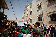 Anti-government protests are held weekly across Syria on Fridays after afternoon prayers. The demonstrations usually involve a cross section of villagers, including many children. Peaceful protests began in March 2011, and have continued throughout the uprising, despite large numbers of people being shot by snipers, purely for demonstrating. al-Basheria, Idlib, Syria.