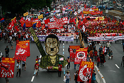 July 24, 2017 - Quezon, Philippines - Thousands of protesters marched through Commonwealth avenue in Quezon City towards the House of Representatives Monday. The protesters aired their dismay during President Duterte's second State of the Nation Address. The protesters also called for the end of Martial Law in Mindanao, and the end of drug related killings in the country. (Credit Image: © J Gerard Seguia via ZUMA Wire)