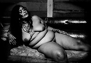 Sunita, a Hindustani-Surinamese (South Asian Indian-Surinamese) sex worker in the room she works in a wooden shed behind a neighborhood bar.  Although the Hindustani-Surinamese community seems to have some of the most prosperous Surinamese within the country, poverty in all its ramifications excludes none of the ethnic communities in Suriname.   Nickerie, Suriname.