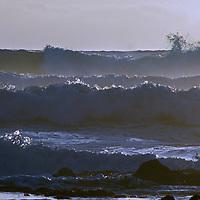 Surf waves break  along California's Pacific Ocean coast near Half Moon Bay.