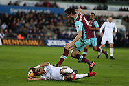 Jefferson Montero of Swansea city is injured by a tackle from Havard Nordtveit of West Ham and has to go off on a stretcher. Premier league match, Swansea city v West Ham United at the Liberty Stadium in Swansea, South Wales on Boxing Day, Monday 26th December 2016.<br /> pic by  Andrew Orchard, Andrew Orchard sports photography.