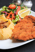 breaded Chicken escalope with mashed potatoes and salad