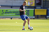 AFC Wimbledon midfielder Mitchell (Mitch) Pinnock (11) warming up during the EFL Sky Bet League 1 match between AFC Wimbledon and Oxford United at the Cherry Red Records Stadium, Kingston, England on 29 September 2018.