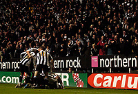 Photo: Jed Wee.<br /> Newcastle United v Reading. The Barclays Premiership. 06/12/2006.<br /> <br /> Newcastle mob Emre after his late goal as the fans celebrate.