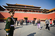 Soldier and tourists at the entrance to the Forbidden City, Beijing, China