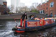 Boatman steers his narrowboat at Gas Street Basin on 14th March 2020 in Birmingham, United Kingdom. Gas Street Basin is a canal basin in the centre of Birmingham, where the Worcester and Birmingham Canal meets the BCN Main Line. It is located on Gas Street, between the Mailbox and Brindleyplace canal-side developments. Redevelopment of central area known as Paradise in Birmingham, United Kingdom. Paradise, formerly named Paradise Circus, is the name given to an area of approximately 7 hectares in Birmingham city centre between Chamberlain and Centenary Squares. The area has been part of the civic centre of Birmingham since the 19th century. From 2015 Argent Group will redevelop the area into new mixed use buildings and public squares.