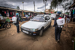 May 9, 2020: Local health workers are  seen along the streets spraying vehilecles with Chemical disinfectant as a preventative measure in Nairobi Kibera. (Credit Image: © Donwilson Odhiambo/ZUMA Wire)