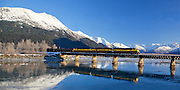 Winter panorama scenic of the Alaska Railroad crossing the bridge over Twentymile River, Turnagain Arm.
