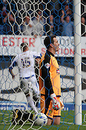Burton Albion's keeper Jon McLaughlin is left picking the ball out of the back of his net as Bury's Ryan Lowe celebrates scoring his sides second goal. Skybet football league two match, Bury v Burton Albion at the JD Stadium, Gigg Lane in Bury, Lancs on Saturday 20th Sept 2014.<br /> pic by David Richards,  Andrew Orchard sports photography.