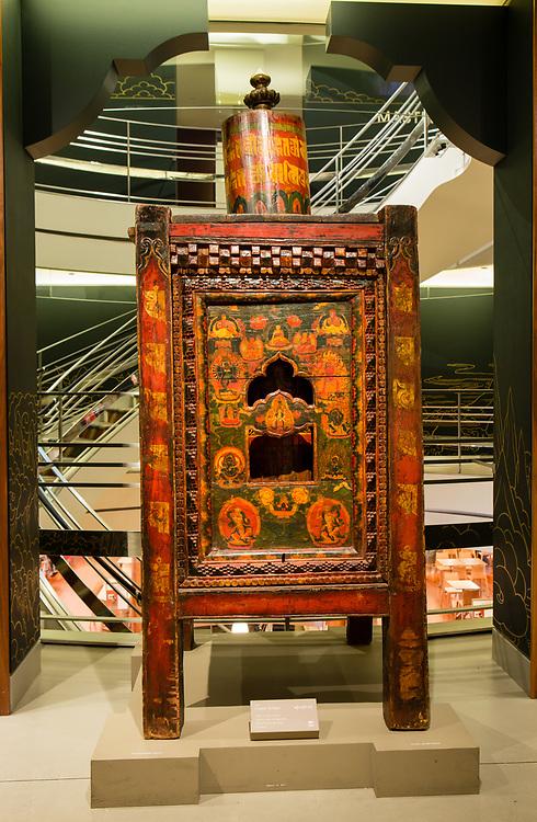 A nineteenth-century Tibetan prayer wheel on display at the Rubin Museum.