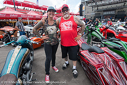 Dave and Jody Perewitz judge bikes at the Perewitz Custom Paint Show at the Iron Horse Saloon during the annual Sturgis Black Hills Motorcycle Rally.  SD, USA.  August 10, 2016.  Photography ©2016 Michael Lichter.