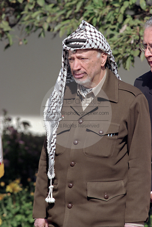 Palestinian leader Yasser Arafat listens as US President Bill Clinton makes a statement prior to the Wye River Summit at the White House October 15, 1998 in Washington, DC. Netanyahu and Arafat are meeting in the US to try and revive the Middle East peace accord.