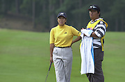 Friday 3rd August 2001.Weetabix Women's British Open..Japan's, Kasumi Fujii, chat's with her caddy at the 11th green.2001 Weetabix Women's Open, Sunningdale,..[Mandatory Credit Peter Spurrier/ Intersport Images]