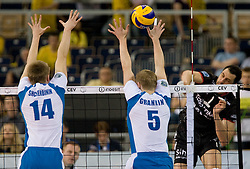 Dmitry Shcherbinin and Sergey Grankin of Dinamo vs Matey Kaziyski of Trentino at  final match of CEV Indesit Champions League FINAL FOUR tournament between Dinamo Moscow, RUS and Trentino BetClic, ITA on May 2, 2010, at Arena Atlas, Lodz, Poland. Trentino defeated Dinamo 3-0 and became Winner of the Champions League. (Photo by Vid Ponikvar / Sportida)