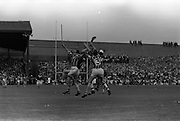 07/09/1969<br /> 09/07/1969<br /> 7 September 1969<br /> All-Ireland Senior Hurling Final: Kilkenny v Cork at Croke Park, Dublin.  <br /> Cork full-forward, R.O. Cuimin (14) reaches out to catch a high ball near the Kilkenny goalmouth with Kilkenny full-back P. Dillon (3).