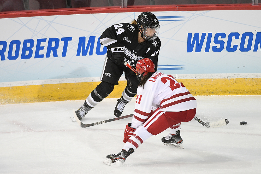 ERIE, PA - MARCH 16: Hayley Lunny #24 of the Providence Friars controls the puck against Nicole LaMantia #21 of the Wisconsin Badgers in the second period during the NCAA Tournament Quarterfinals game at the Erie Insurance Arena on March 16, 2021 in Erie, Pennsylvania. (Photo by Justin Berl)