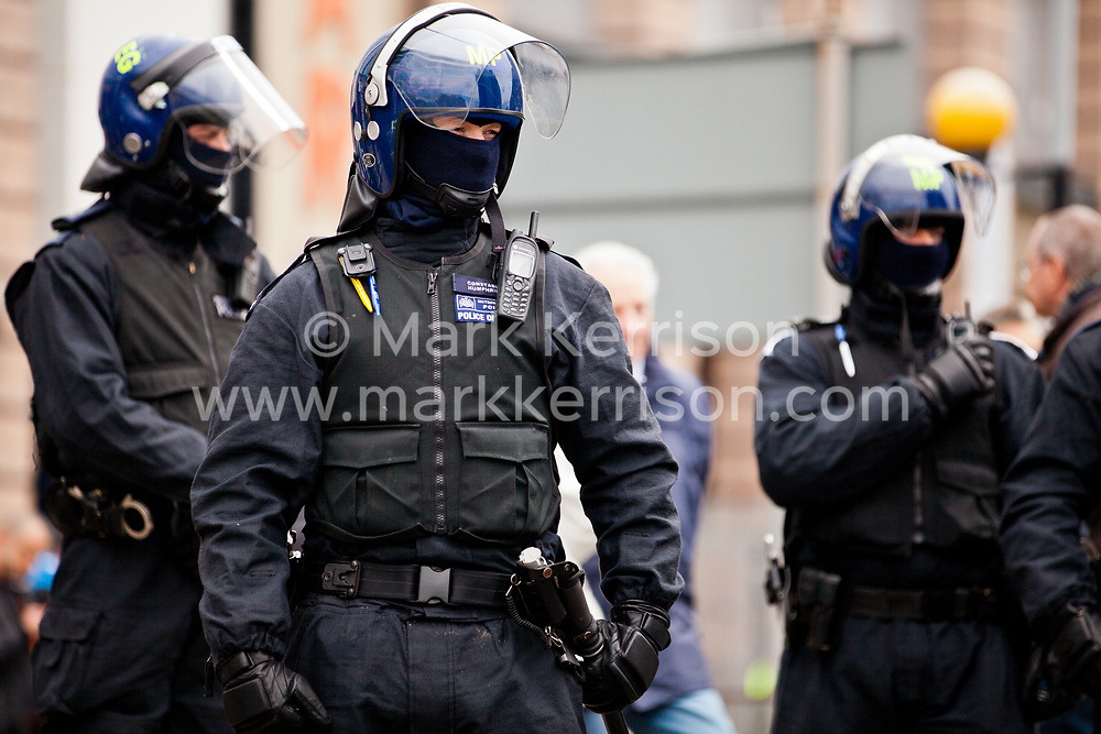 Luton, UK. 5th May, 2012. Riot police officers deployed to separate supporters of Unite Against Fascism attending the We Are Luton/Stop The EDL march from supporters of the far-right English Defence League. Around 1,500 police were deployed in Luton for the rival marches from twenty forces around the UK.