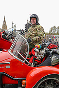 London, UK, May, 8, 2021 — A British war veteran is seen leaving central London along with his dog (pet) on a tricycle after a 'Respect our Veterans' march in Parliament Square, central London on Saturday, May 8, 2021. The march follows the collapse of the controversial trial earlier this week against two paratroopers accused of murdering Official IRA leader Joe McCann in 1972. (Photo/ Vudi Xhymshiti)