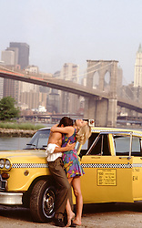 sexy couple near a taxi in New York City