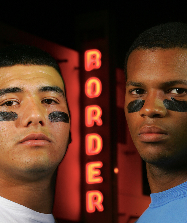 Photo by Alex Jones..Juan Martinez of La Joya and Bradley Stephens of McAllen Memorial pose for The Monitor's 5A football tab cover in front of the Border theater in downtown Mission.
