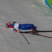 Winter Olympics, Vancouver, 2010.Alexander Legkov, Russia lays collapsed on the ground after finishing fourth in the Men's 30km Pursuit Cross Country event at Whistler Olympic Park, Whistler, during the Vancouver Winter Olympics. 20th February 2010. Photo Tim Clayton
