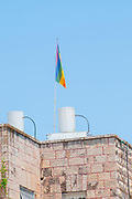 Gay flag on a mast on a roof. Photographed in Jerusalem, Israel