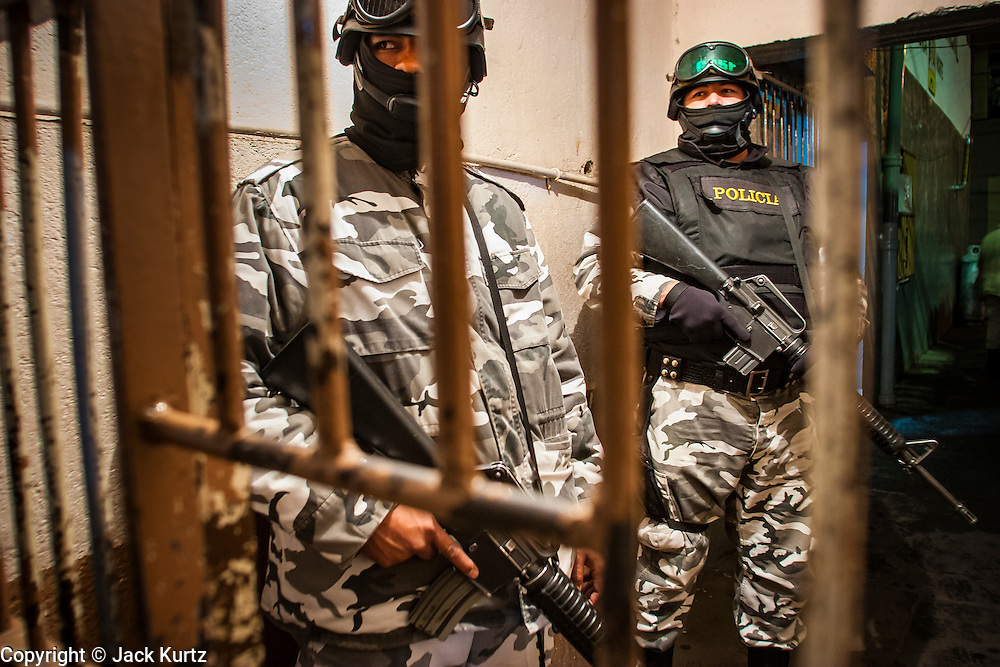 """05 FEBRUARY 2005 - NOGALES, SONORA, MEXICO: Nogales, Mexico, stand in the doorway of the city jail. Members of """"Grupo Operativos"""" a special operations unit of the Nogales, Sonora, Mexico, police department, on patrol in Nogales, Saturday night, Feb. 5. The Operativos specialize in anti-gang enforcement and drug interdiction missions. In recent months they have stepped up patrol activity in Nogales communities near the border. In January 2005, the US Department of State has issued a travel advisory advising US citizens to avoid travel along the US Mexican border because of increased violence, including the kidnapping of US citizens, in border communities. Most of the violence has been linked to the drug cartels, who are increasingly powerful in Mexico. The Operativos also patrol the districts of Nogales frequented by US tourists in an effort to prevent crime directed against US citizens.   PHOTO BY JACK KURTZ"""