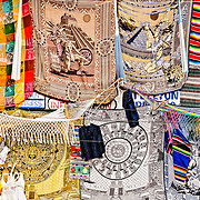 Tourist shop selling Mayan-inspired textiles and other souvenirs in the parking lot of the Coba Mayan site not far from Tulum on Mexico's Yucatan peninsula. at Coba, an expansive Mayan site on Mexico's Yucatan Peninsula not far from the more famous Tulum ruins. Nestled between two lakes, Coba is estimated to have been home to at least 50,000 residents at its pre-Colombian peak.