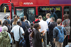 © Licensed to London News Pictures. 08/07/2015. London, UK. City workers queuing to get on a bus near Liverpool Street station in London. London transport workers begin strike action tonight, which will continue tomorrow. Photo credit : Vickie Flores/LNP