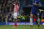 Saido Berahino of Stoke city holds his head in dejection. <br /> Premier league match, Chelsea v Stoke city at Stamford Bridge in London on Saturday 30th December 2017.<br /> pic by Kieran Clarke, Andrew Orchard sports photography.