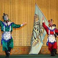 Asia, China, Beijing. Beijing Opera Performers and flag.