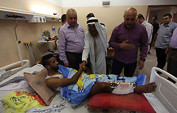 June 16, 2018 - Gaza City, Gaza Strip, Palestinian Territory - Palestinian members of the National Commission to break the siege, visit the youths who were wounded during clashes with Israeli troops at the Israel-Gaza border on the second day of Eid al-Fitr holiday at al-shifa hospital in Gaza city on June 16, 2018  (Credit Image: © Mahmoud Ajour/APA Images via ZUMA Wire)