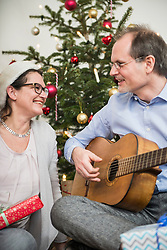 Couple singing and playing guitar