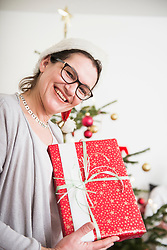 Portrait of mature woman with Christmas present