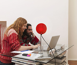 Feb. 03, 2009 - Couple on laptop, using credit card. Model and Property Released (MR&PR) (Credit Image: © Cultura/ZUMAPRESS.com)