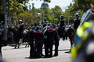 Police arrest a man during the Melbourne Freedom Rally at Parliament House. Police move into position on the steps of state parliament ahead of a planed protest. The groups who have organised the many Freedom Day protests over the last 3 months, attempted to march on State Parliament during Melbourne Cup Day demanding the sacking of Premier Daniel Andrews for the lockdown and attacks on their civil liberties. Police met with the protester's with significant force despite the city having had zero cases for five days. (Photo by Dave Hewison/Speed Media)