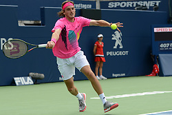 August 9, 2018 - Toronto, Ontario, Canada - STEFANOS TSITSIPAS of Greece in action in his third round match vs. N. Djokovic in the Rogers Cup tennis tournament in Toronto Canada. In an upset Tsitsipas beat Djokovic 6-3, 6-7 (5), 6-3. (Credit Image: © Christopher Levy via ZUMA Wire)