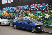 Crime in the City street art graffiti in Digbeth, Birmingham, England, United Kingdom. Digbeth is an area of Central Birmingham, England. Following the destruction of the Inner Ring Road, Digbeth is now considered a district within Birmingham City Centre. As part of the Big City Plan, Digbeth is undergoing a large redevelopment scheme that will regenerate the old industrial buildings into apartments, retail premises, offices and arts facilities. There is still however much industrial activity in the south of the area.